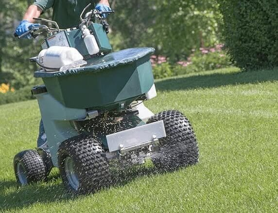 Fertilization services being performed by a New Hampshire commercial landscaper