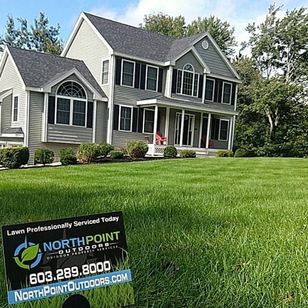 House with beautiful healthy green lawn in New Hampshire